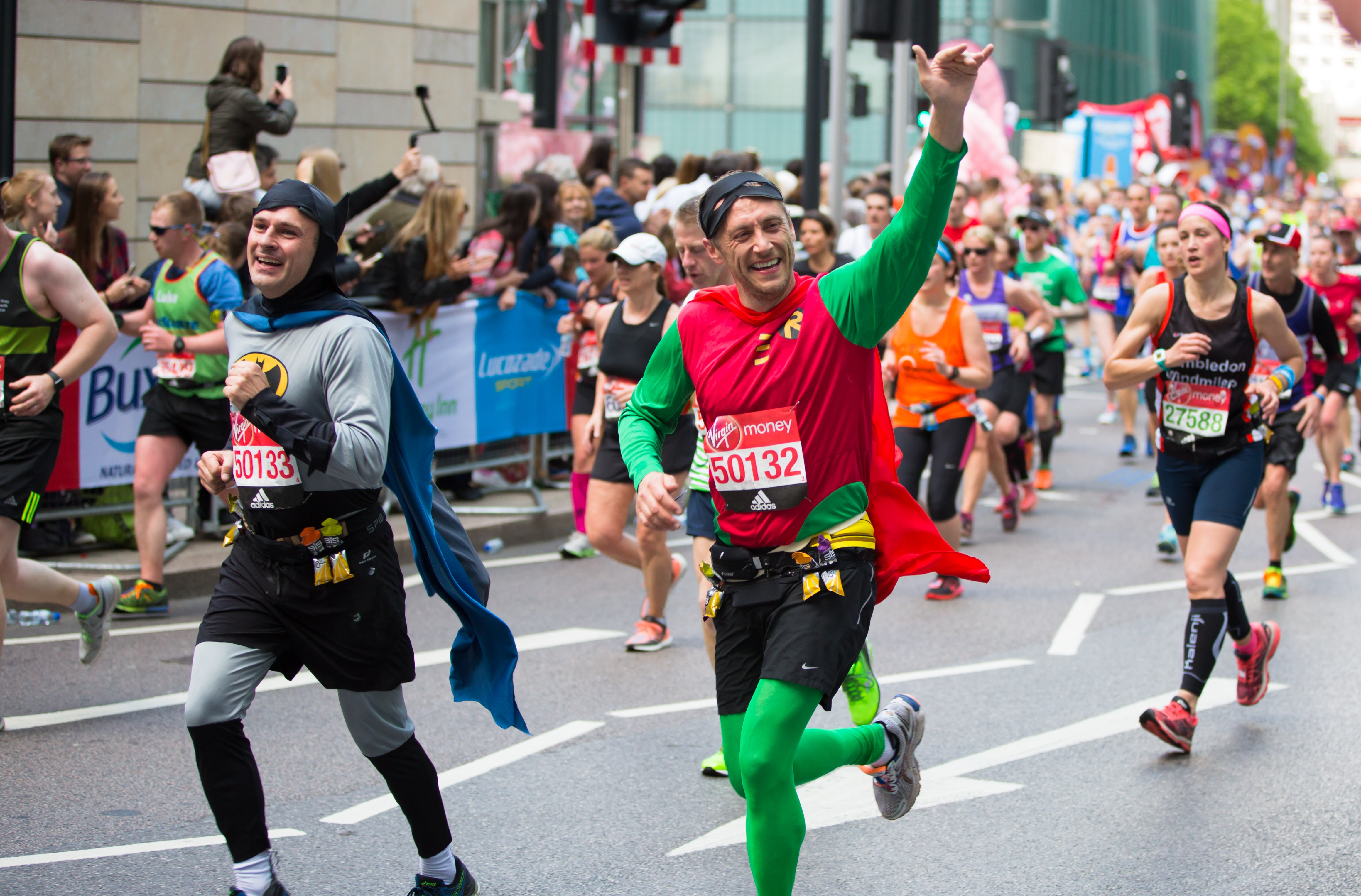 Two happy London Marathon runners in batman and Robin outfits