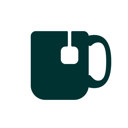 white circle sticker with a green mug and teabag string hanging down the side of the mug.